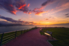 Benches in park in Getxo at sunset Stock Image