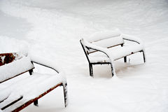 Benches in Park of Moscow after heavy snow Stock Photos