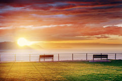 Benches in park with at sunset Royalty Free Stock Images