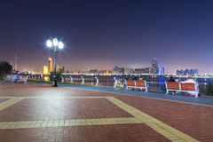 Benches at Persian Gulf in Abu Dhabi at night Stock Photo