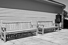 Benches and phone stand. Black and white picture royalty free stock image