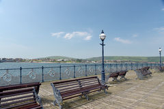 Benches on pier at Swanage Royalty Free Stock Image