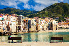 Benches in the port of Cefalu Royalty Free Stock Images