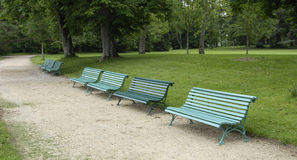 Benches in a public park Royalty Free Stock Photo