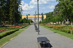 Benches in Public Park. Of Vrnjacka Banja, Serbia, with colorful flowers in summertime Royalty Free Stock Photography
