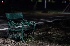 Benches in public park at night time. Concept lonely in the darkness with nature royalty free stock photos