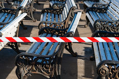 Benches in a public park are in preparation for the coming summe Royalty Free Stock Photography