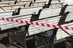 Benches in a public park are in preparation for the coming summe Stock Photos