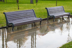 Benches among the puddles. In Minsk, Belarus Royalty Free Stock Image