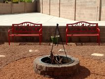Benches. Red, fire, pit, rocks royalty free stock photography