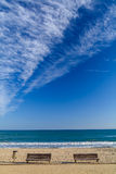 Benches on the sandy beach landscape in Tarragona Spain Royalty Free Stock Photos