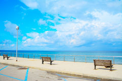 Benches by the sea in Sardinia Royalty Free Stock Images