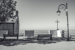 Benches, Simple Church and Cross lookin over Mediteranean Stock Photos
