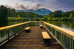 Benches on a small pier and view of Table Rock at Lake Oolenoy, Stock Images