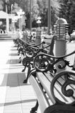 Benches stand in a row Stock Images