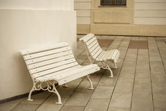 Benches, standing near the building Royalty Free Stock Photos