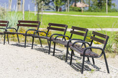 Benches standing in a park. Stock Photos
