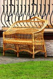 Benches. On the street near the building costs wicker bench for rest Royalty Free Stock Photos