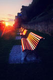 Benches at sunset reflecting sunlight Royalty Free Stock Images