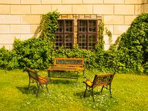 Benches and table in the castle garden Stock Images