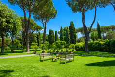 Benches and a table in the garden. Sunny day Royalty Free Stock Photos