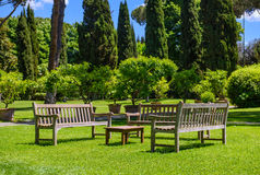 Benches and a table in the garden. Sunny day Stock Photo