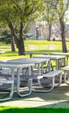 Benches and tables in the public park on the green meadow on a sunny day. Great for many people for the birthday party and. Celebrations royalty free stock photography