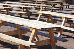 Benches and tables. Several benches and tables outside ready to be used Stock Photography