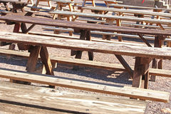 Benches and tables. Several benches and tables outside ready to be used Royalty Free Stock Image