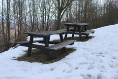 Benches and tables in the snow Royalty Free Stock Photos
