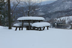 Benches and tables under the snow Royalty Free Stock Image