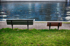 Benches together in park Stock Image
