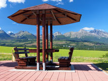 Benches under shelter and High Tatras stock image