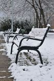 Benches under the snow in winter, in Budapest, Hungary. A winter outside photo made in a park in Budapest after snowfall Stock Photos