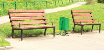 The benches and urns. In the alley Stock Photo
