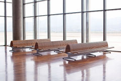 Benches in the waiting area of an airport Royalty Free Stock Photos