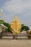 Benches at Wat Rong Khun, Chiang Rai, Thailand. Benches with golden sculpture background Royalty Free Stock Images