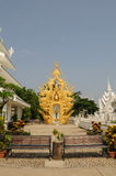 Benches at Wat Rong Khun, Chiang Rai, Thailand. Benches with golden sculpture background Stock Images