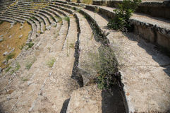 Benches of the west theatre in Laodicea on the Lycus. Benches of the west theatre at ancient Laodikeia city at the Denizli Province, Laodicea on the Lycus Royalty Free Stock Photo