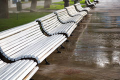 Benches, wet after rain Royalty Free Stock Photos