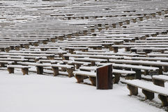 Benches in the winter. Benches which are placed in an open-air cinema in a shape of an amphitheatre royalty free stock image