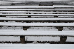 Benches in the winter. Benches which are placed in an open-air cinema Royalty Free Stock Images