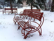 Benches  during winter in park covered Stock Images