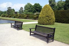 Benches at Hever Castle garden in Kent, England Royalty Free Stock Photo