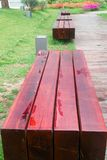 Benches by wooden road Royalty Free Stock Photos