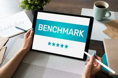 BENCHMARK, business processes and performance metrics to industry bests practices from other companies. BENCHMARK, business processes and performance metrics to stock image