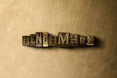 BENCHMARK - close-up of grungy vintage typeset word on metal backdrop Royalty Free Stock Images