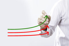 Benchmarking and market leader concept. Manager businessman, co. Ach, leadership draw graph with three lines, one of them represent the best company in royalty free stock images