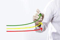 Benchmarking and market leader concept. Manager businessman, co. Ach, leadership draw graph with three lines, one of them represent the best company in royalty free stock photos
