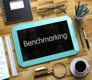 Benchmarking on Small Chalkboard. 3D Illustration. Benchmarking Handwritten on Mint Chalkboard. Top View Composition with Small Chalkboard on Working Table with stock photography